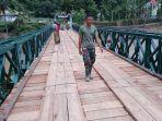 jembatan-bailey-munte-yang-menghungkan-desa-bontomatene-dan-desa-mangepong.jpg