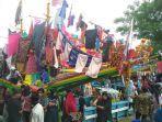 kapal-hias-berisi-bakul-maudu-pada-perayaan-maudu-lompoa-di-cikoang-kabupaten-takalar.jpg