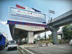 kendaraan-melintas-di-bawah-jembatan-tol-layang-ap-pettarani-makassar-1.jpg