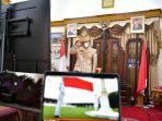 konferensi-video-dengan-presiden-gubernur-na-mengenakan-baju-adat-bugis-makassar.jpg