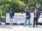 ldii-sulawesi-selatan-membagi-bagikan-masker-kepada-pengguna-jalan-di-daya.jpg