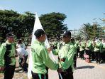muchlis-melepas-kontingen-porseni-pgri-kabupaten-gowa.jpg