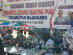 pc-pgri-kecamatan-majauleng-bagikan-1000-masker-di-pasar-atapangnge.jpg
