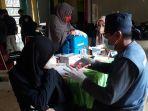 pelajar-antusias-mengikuti-vaksinasi-covid-19-di-gedung-simpurusiang-jl-soekarno-hatta.jpg
