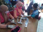 pelaksanaan-vaksin-oleh-tenaga-kesehatan-kepada-aparatur-pemerintah-desa-di-sinjai.jpg