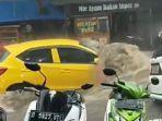 pemilik-mobil-kuning-hanyut-banjir-bandung.jpg