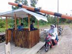 pengunjung-sedang-membeyar-retribusi-di-pantai-mallenreng-desa-panaikang-kecamatan-sinjai.jpg
