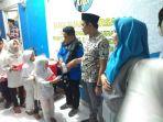 pengurus-komite-nasional-pemuda-indonesia-knpi-sulsel-menyantuni-anak-yatim-pintu_20180605_212257.jpg