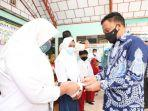 penyaluran-beasiswa-siswa-dan-siswi-berprestasi-di-kantor-desa-labbo-kecamatan-tompobulu.jpg