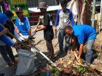 peserta-bbkt-sulbar-2019-bersihkan-kompleks-pasar-tinambung.jpg