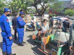 petugas-gabungan-polisi-dan-satuan-polisi-pamong-praja-melakukan-sosialisasi-perbup.jpg