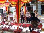 polisi-hentikan-resepsi-pernikahan-di-hotel-pantan-makale-tana-toraja-senin-412021.jpg