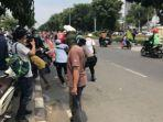 polisi-menangkap-satu-simpatisan-rizieq-shihab-di-pengadilan-negeri-jakarta-timur.jpg