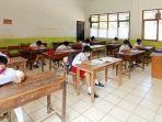proses-ujian-sekolah-di-sdn-213-inpres-lemo-tana-toraja-menerapkan-prokes-covid-19.jpg