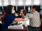 proses-vaksinasi-di-gedung-tammuan-mali-makale-tana-toraja-sabtu-632021.jpg