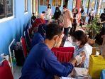 proses-vaksinasi-pelajar-yang-dilakukan-di-dinas-pendidikan-dan-kebudayaan-kabupaten-wajo.jpg