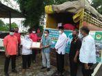prosesi-pelepasan-bantuan-dari-warga-lembaga-dakwah-islam-indonesia-ldii.jpg