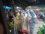 puluhan-pengunjung-dan-pedagang-di-pasar-lawawoi-kecamatan-watang-pulu-kabupaten-sidrap.jpg