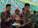 rektor-unismuh-makassar-dampingi-ketum-pp-muhammadiyah-prof-haedar.jpg