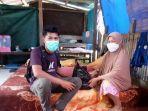 relawan-kopel-sulawesi-menyerahkan-bantuan-kepada-korban-gempa-sulbar-di-majene.jpg