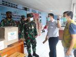 relawan-yayasan-buddha-tzu-chi-indonesia-menyerahkan-bantuan-kepada-aspotdirga-kaskoopsau1.jpg