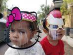 sejumlah-anak-menggunakan-pelindung-wajah-face-shield-1.jpg