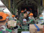 sejumlah-bantuan-diangkut-hercules-tni-au-tiba-di-bandara-tampa-padang-kabupaten-mamuju-1.jpg