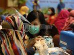 sejumlah-warga-mengikuti-vaksinasi-covid-19-yang-berlangsung-di-makassar-golden-hotel-3.jpg