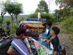 seorang-ibu-hamil-di-kecamatan-malunda-harus-diangkut-menggunakan-mobil-polisi.jpg
