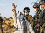 seorang-warga-palestina-suleyman-al-hadhalin-bereaksi-terhadap-pasukan-israel.jpg