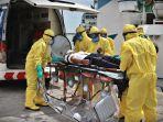 suasana-simulasi-tim-medis-mengevakuasi-seorang-warga-negara-asing-wna-4.jpg