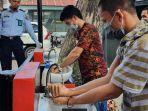 tahanan-baru-diwajibkan-mencuci-tangan-lembaga-rumah-tahanan-rutan-kelas-i-makassar.jpg