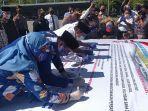 tiga-paslon-di-pilkada-maros-2020-menandatangani-deklarasi-pilkada-damai.jpg