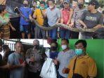 ular-piton-sepanjang-empat-meter-gegerkan-warga-inspeksi-kanal-jl-andi-djemma.jpg