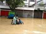 video-3-orang-tewas-saat-banjir-bandang-di-medan-akibat-sungai-deli-meluap-imbauan-gubernur-edy.jpg