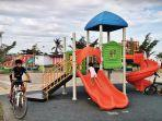 warga-menikmati-sejumlah-fasilitas-di-ruang-terbuka-hijau-rth-taman-emmy-saelan-1.jpg