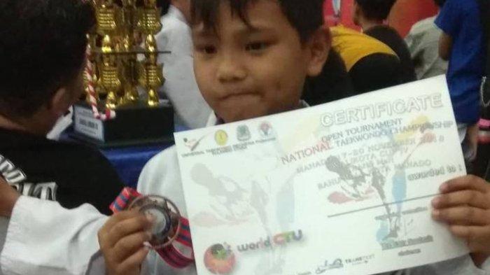 Michael CN Takalamingan Sukses Raih Perunggu di Kejuaraan Taekwondo Wali Kota Manado Cup IV