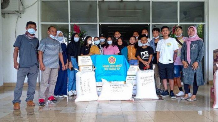 Warga Bolmong Kumpul Beras Untuk Korban Bencana Manado