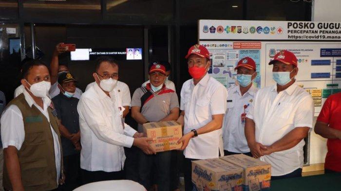 Pemkab Bolsel Salurkan Bantuan Bagi Korban Banjir di Manado