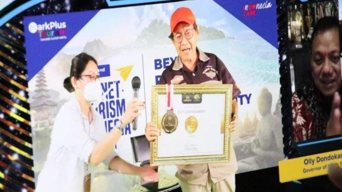 Bertepatan dengan momen HUT Ke-57 Provinsi Sulut, MarkPlus Inc menganugrerahkan Penghargaan CI-EL Medal of Distinction 2021 kepada Gubernur Olly.