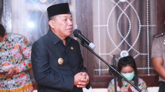 Bupati Bolaang Mongondow Utara (Bolmut) Drs Hi Depri Pontoh menghadiri upacara Hari Ulang Tahun Bhayangkara Ke 75