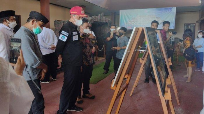 Bupati Bolmong Selatan Iskandar Kamaru menghadiri kegiatan pameran arkeologi se-Bolaang Mongondow Raya.