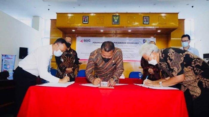 Bupati Bolmut Depri Pontoh Tandatangani Nota Kesepahaman Bersama BPKP dan Bank SulutGo
