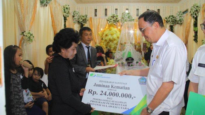 Bupati Minahasa Berikan Santunan Duka dari BPJS Ketenagakerjaan Senilai Rp 24 Juta