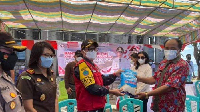 Bupati Minut Joune Ganda Bawa Bantuan untuk Empat Desa di Pulau Bangka