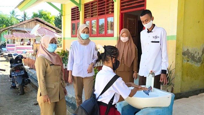 Dinkes Bolmut Terjun Lapangan Berikan Edukasi Pencegahan Covid-19 Kepada Masyarakat