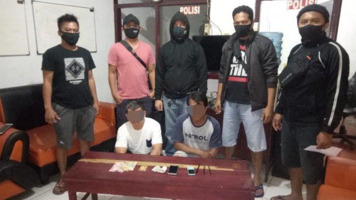 Dua Warga Mongkonai Tertangkap Sedang Main Togel