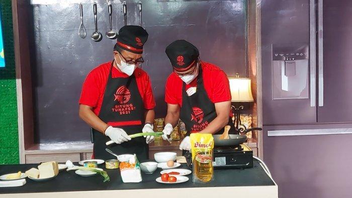 Duel masak Wali Kota Bitung Maurits Mantiri – Wakil Wali Kota Bitung Hengky Honandar versus Ever Salikara (Slkr) – Tian Storm di Bitung Tuna Fest Virtual 2021.