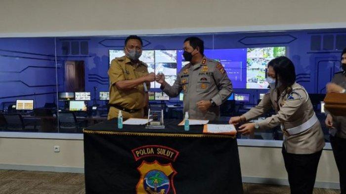 Gubernur Sulut Olly Dondokambey saat menghadiri Penandatanganan MoU instansi pemerintah/non pemerintah dengan Polda Sulut di ruang Command Center Polda Sulut, Selasa (20/4/2021).