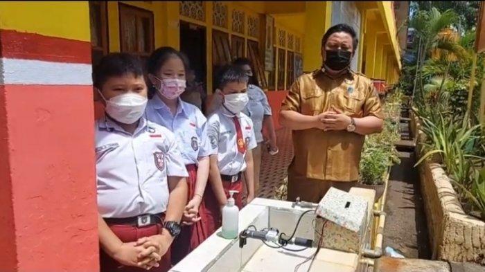 Begini Cara Kerja Mesin Cuci Tangan Tanpa Sentuh yang Diciptakan Tiga Pelajar SD di Bitung